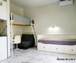 Пятиместные апартаменты на первом этаже с кухней и балконом в комплексе «Капри» № 31